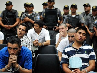 PHOTO:  Suspected members of the Mexican drug cartel 'Los Zetas' from Guatemala and Mexico are guarded by police.