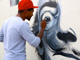 PHOTO: Pensacola artist Carlos Beck was commissioned to paint this wall for Art Basel 2012 in Miami's Wynwood District.
