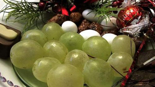 The tradition of celebrating New Year's Eve by eating 12 grapes probably originated in , when Vinalopó grape producers in Alicante promoted consumption of the fruit due to overproduction.