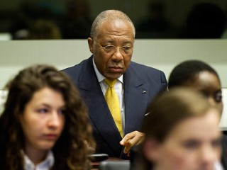 PHOTO: Former Liberian President Charles Taylor waits for the start of his sentencing judgement in the courtroom of the Special Court for Sierra Leone(SCSL) in Leidschendam, near The Hague, ...