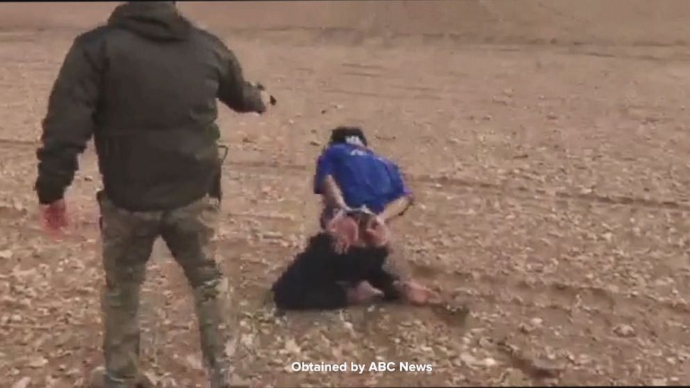 PHOTO: Cpl. Haider Ali sent Arkady a video showing Capt. Omar Nazar and Cpl. Haider Ali executing a bound prisoner.