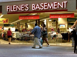 PHOTO: Passersby come and go from a Filene's Basement discount clothing store in a mall in Watertown, Mass., in this file photo.