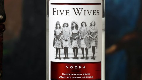 bottle of five wives vodka, there are 5 women holding small cats, dressed from the 1880's
