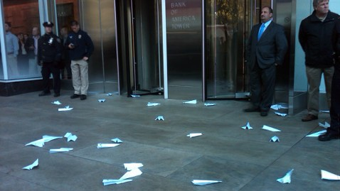 ht paper planes b of A sign nt 111028 wblog Occupy Wall Street Protesters March to Bank Offices; Generators Taken Away