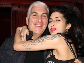 PHOTO: Amy Winehouse and her father Mitch Winehouse sighted outside Cityburlesque where her father was playing a gig on Oct. 7, 2010 in London, England.