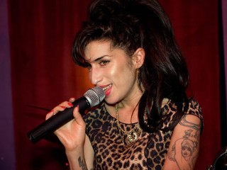 PHOTO: Amy Winehouse performs at the launch party of City Burlesque on Oct. 7, 2010, in London.