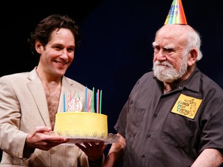"PHOTO: Paul Rudd and Ed Asner appear on stage at the Ed Asner Birthday Celebration With The Cast Of ""Grace"" at Cort Theatre on Nov. 15, 2012 in New York City."
