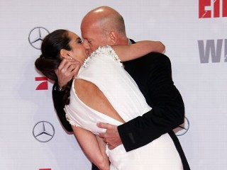 PHOTO: Bruce Willis and his wife Emma Willis attend the 'Die Hard - Ein Guter Tag Zum Sterben' Germany premiere at CineStar Sony Center, Feb. 4, 2013, in Berlin.