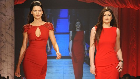 gty red dress fashion week show kyle kendall jenner thg 130207 wblog Celebs Rule Runway at Heart Truth Fashion Show