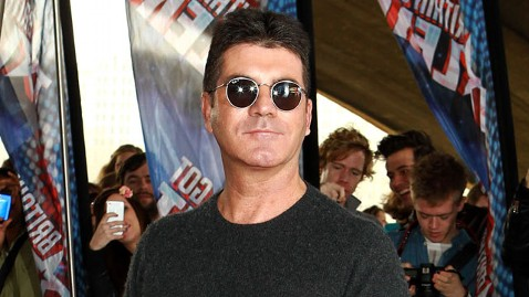 gty simon cowell ll 120327 wblog Brick Wielding Woman Breaks Into Simon Cowells London Home