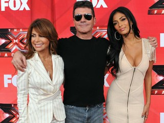 PHOTO: Judges Paula Abdul, Simon Cowell and Nicole Scherzinger pose at The X Factor Press Conference at CBS Televison City in this Dec. 19, 2011 file photo in Los Angeles, Cali.