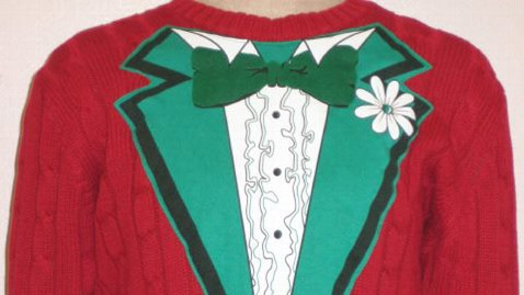 ht tuxedo sweater nt 121205 wblog Woman Cashes in on Tacky Christmas Sweater Craze