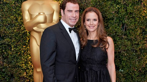 nc kelly preston john travolta ll 111129 wblog Celebrity Weight Loss Secrets: How Kelly Preston, Gisele Bundchen and Padma Lakshmi Got Their Pre Baby Bodies Back