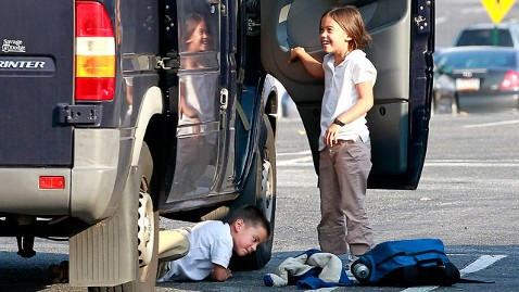 pcn gosselin kid under bus dm 111104 wblog Kate Gosselin Slammed After Son Crawls Under Van