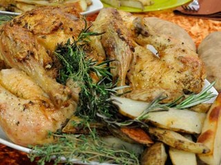 Emeril's Garlic Schmeared Rosemary Roast Chicken