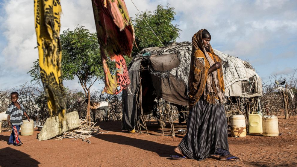PHOTO: A woman walks through her family's compound in Dadaab refugee camp. Dadaab camp in northeast Kenya is the world's largest refugee settlement, and hosts more than a third of a million Somali refugees.