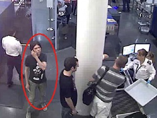PHOTO: This surveillance image provided by Interpol shows who authorities believe is Luka Rocco Magnotta at a security checkpoint area.