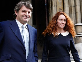 PHOTO: Rebekah Brooks, former chief executive of News International and her husband Charlie Brooks leave the High Court in London after giving evidence to the Leveson Inquiry, in this May 11, 2012 ...