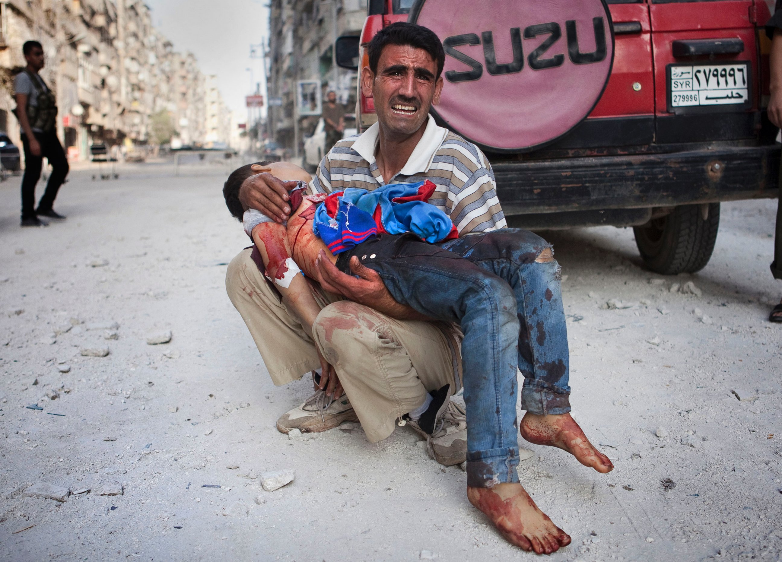 epa syria father dead child 50546784 ll 121005 State: 17,800 Plus People Killed Globally in Terrorist Attacks in 2013