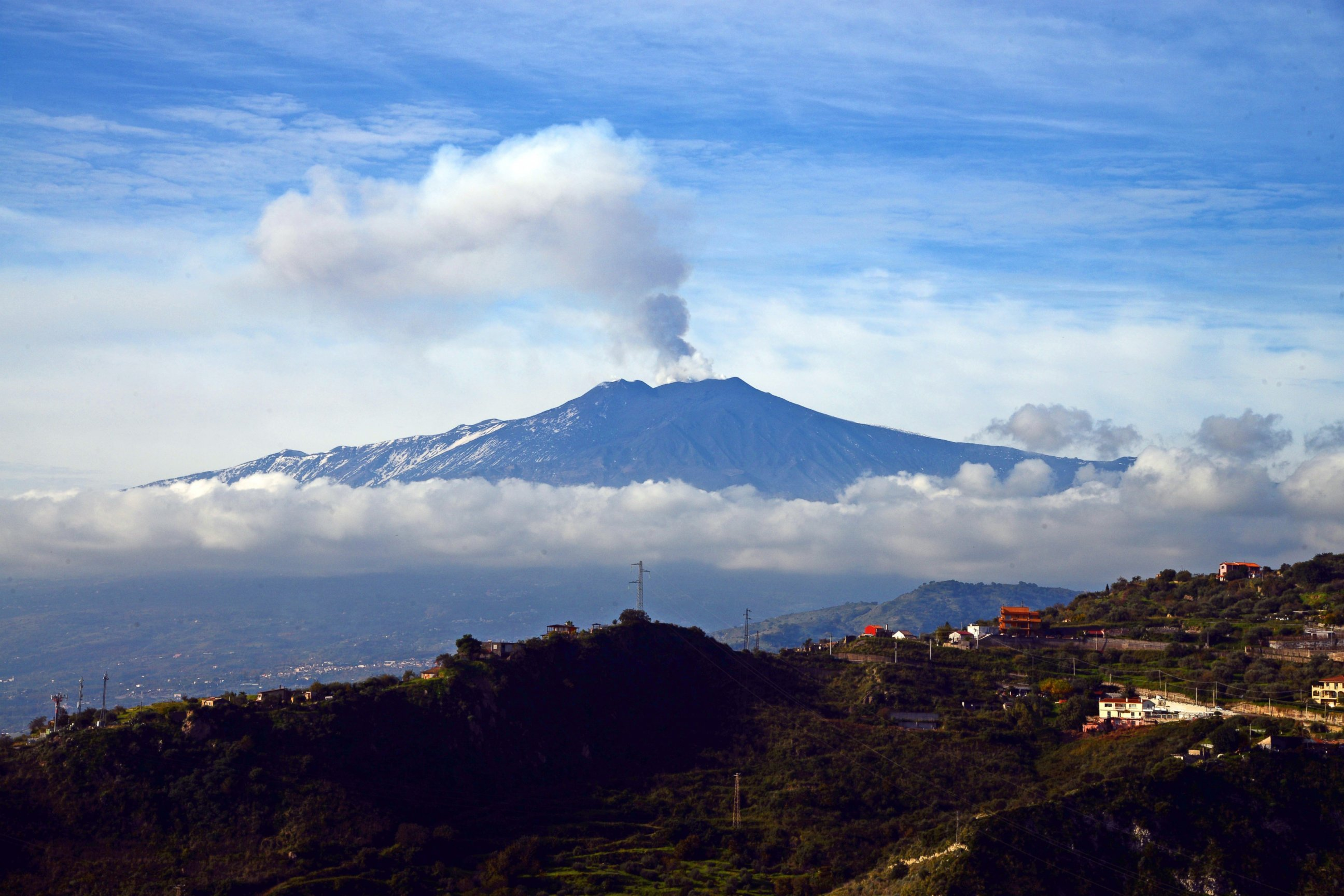 PHOTO: Smoke rises over the city of Taormina during an eruption of the Mount Etna, one of the