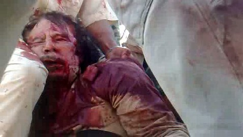 gty moammar gadhafi shirt dm 120202 wblog Gadhafis Bloody Shirt and Wedding Ring on Sale for $2M