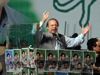 PHOTO: Former Pakistani Prime Minister Nawaz Sharif addresses his supporters during an election campaign meeting in Rawalpindi on May 7, 2013. The election will mark a democratic milestone in a ...