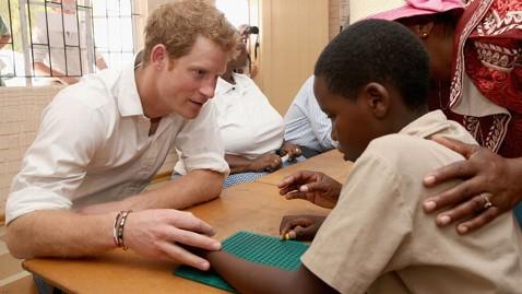 gty prince harry teaching brail lesotho thg 130227 wblog Prince Harry In Class: From Cooking to Sign Language