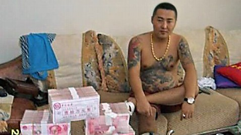 ht gangster china dm 120321 wblog Viral Pics Show Chinese Gangsta Fondling Porsches, Puppies and Purse
