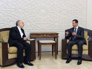 PHOTO: Syrian President Assad, left, and Iranian Foreign Minister Salehi, right, meet in Damascus on May 7, 2013.