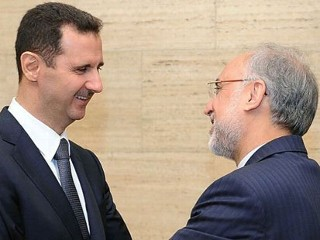 PHOTO: Syrian President Assad and Iranian Foreign Minister Salehi meet in Damascus on May 7, 2013.