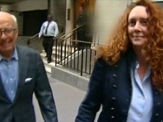 VIDEO: Rupert Murdoch protege Rebekah Brooks and former David Cameron aide Andy Coulson both charged.