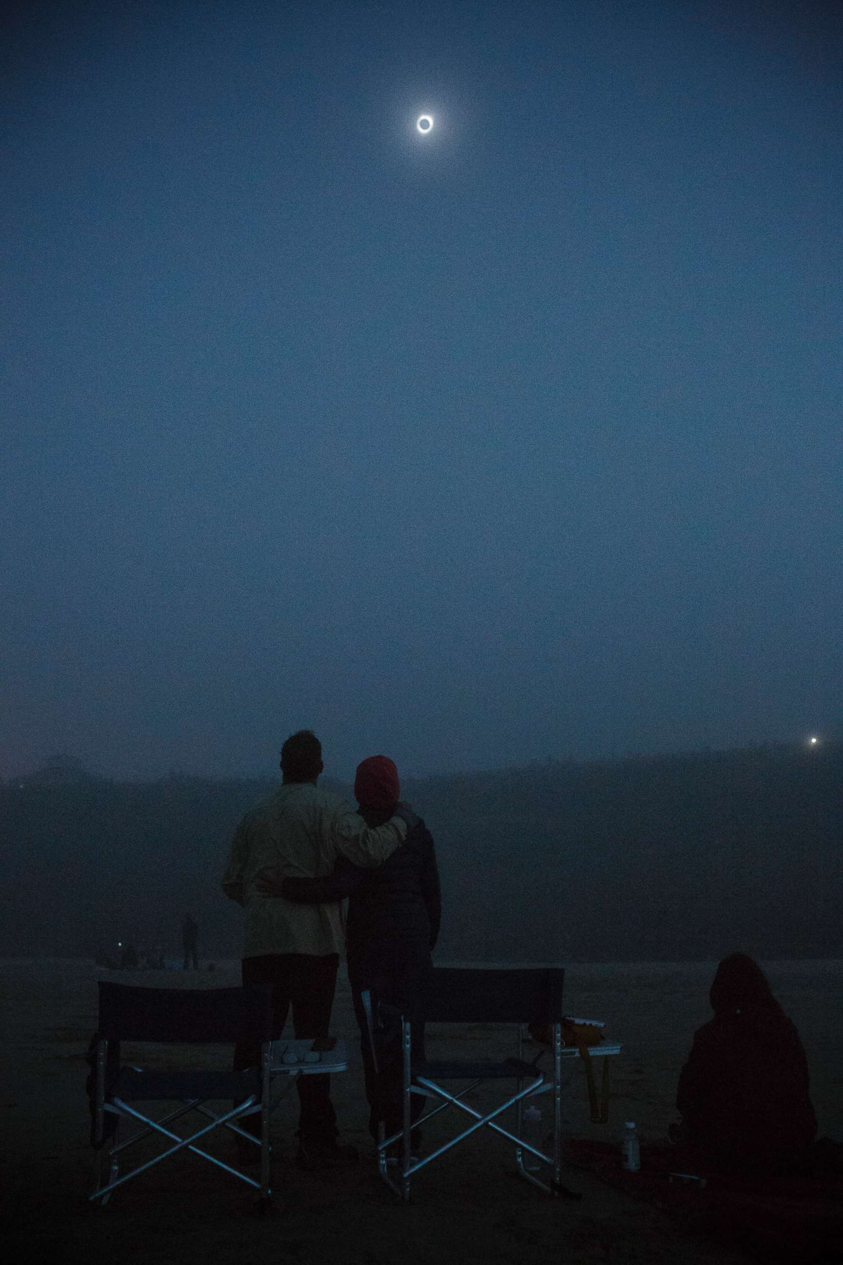 Image result for John Tocco and Ursula Marinelli view the total solar eclipse in Newport, Ore., Aug. 21, 2017.