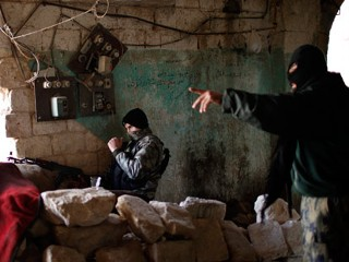 PHOTO: Fighters from Islamist Syrian rebel group Jabhat al-Nusra take their positions on the front line during a clash with Syrian forces loyal to President Bashar al Assad in Aleppo, Dec. 24, 2012.