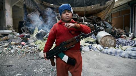 spa sipausa almed smoking with ak 47 in aleppo jt 130330 wblog Photo Captures Face of War in an 8 Year Old Boy