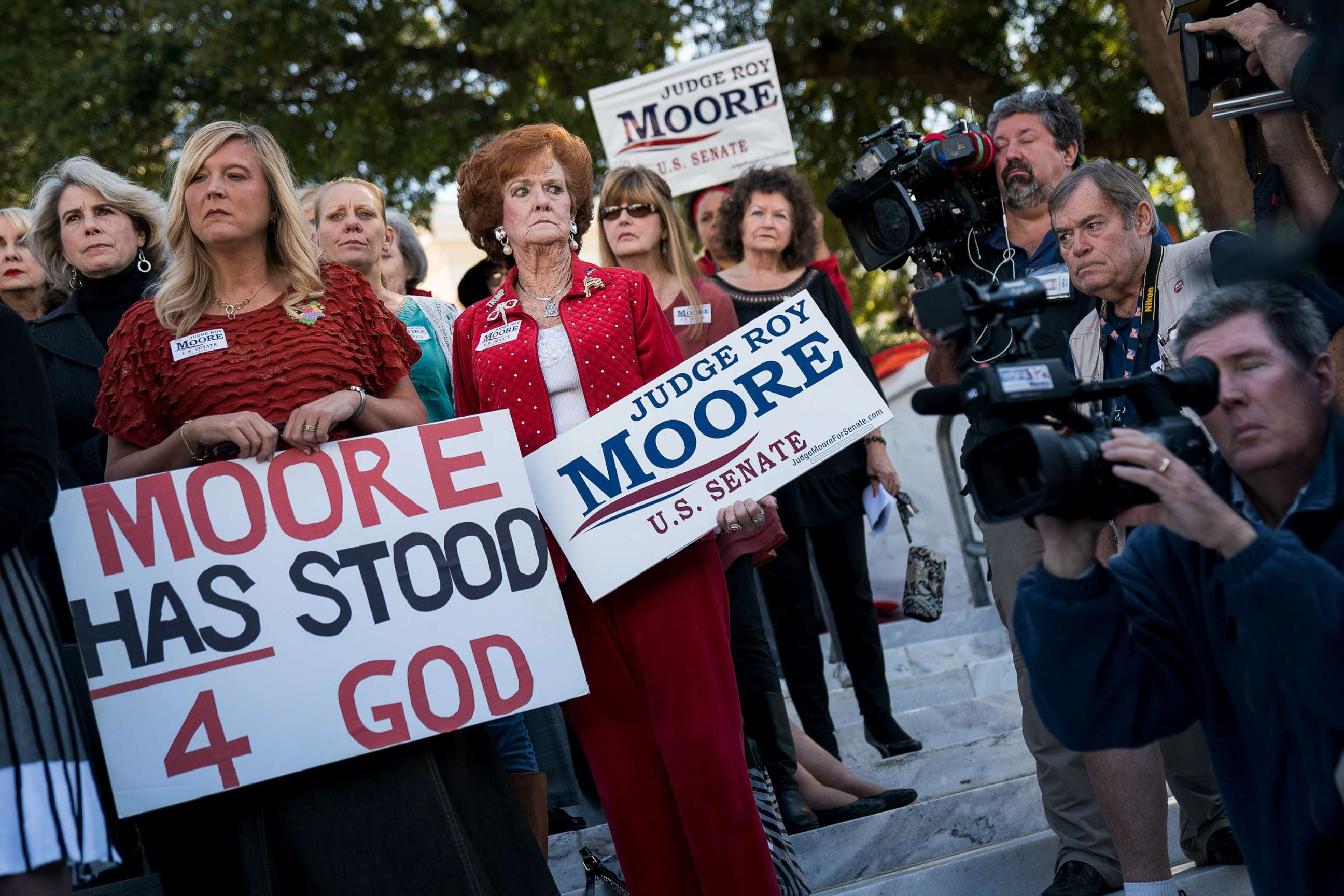 Image result for Women attend a Women for Moore rally for Alabama Republican U.S. Senate candidate Roy Moore in front of the Alabama Capitol, Nov. 17, 2017, in Montgomery.