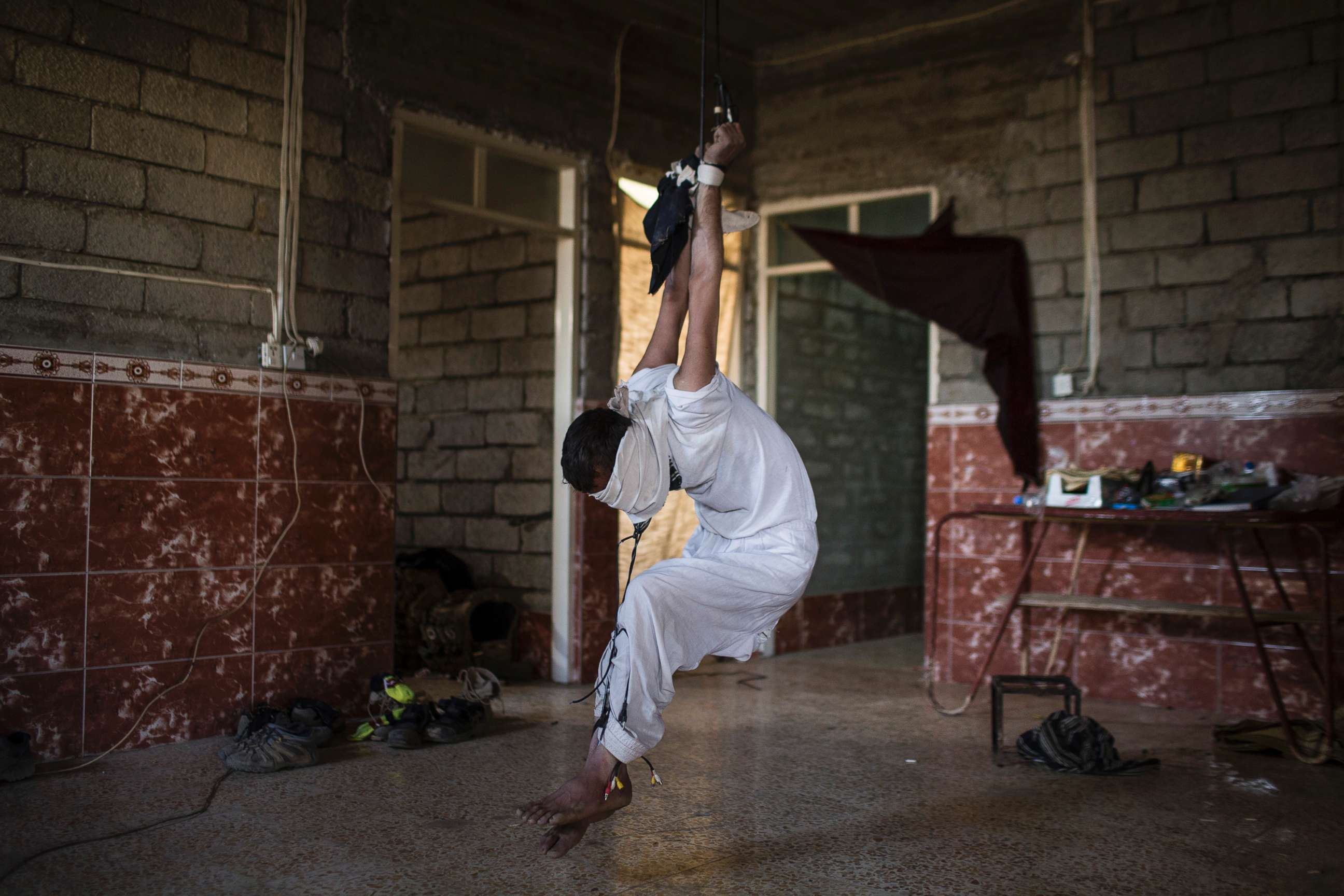 Image result for Photojournalist Ali Arkady documented human right abuses including torture while following elite Iraqi troops leading the fight against ISIS in Mosul, Iraq.