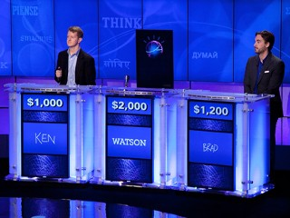 "PHOTO: (L-R) Contestants Ken Jennings and Brad Rutter compete against 'Watson' at a press conference to discuss the upcoming Man V. Machine ""Jeopardy!"" competition at the IBM T.J. Watson Research ..."