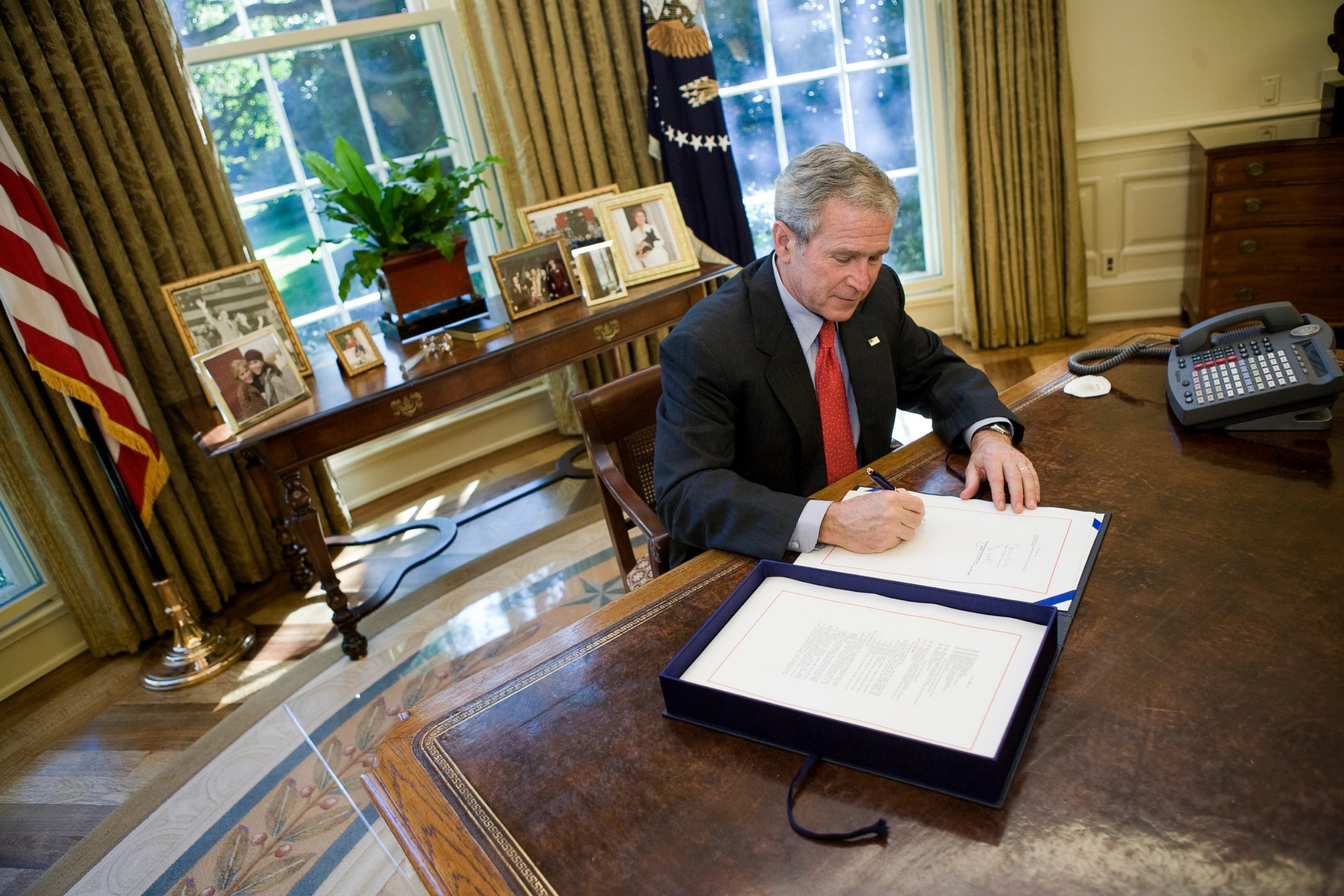 george bush oval office. photo: president george w. bush signs a wall street bailout bill in the oval office - abc news g