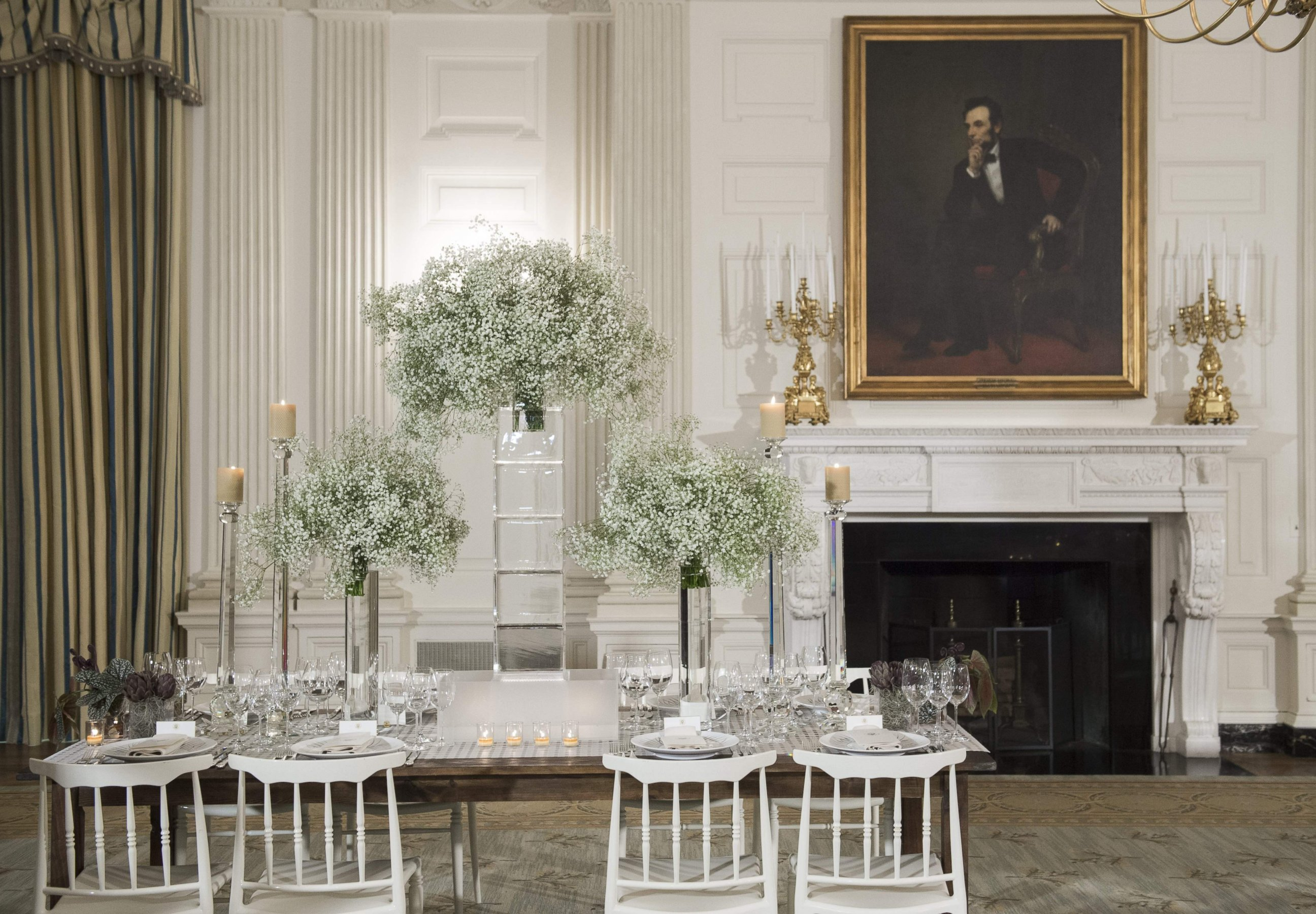 Photo a sample table setting is seen during a press preview of a of a state dinner in honor of the nordic countries including sweden norway finland denmark and iceland in the state dining room of the white house dzzzfo