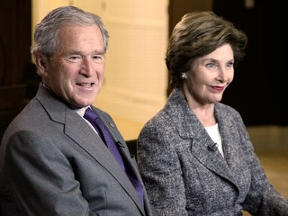 "PHOTO: George W. Bush and former first lady Laura Bush speak to ABC ""World News"" anchor Diane Sawyer as they prepare for the opening and dedication of the George W. Bush Presidential Center."