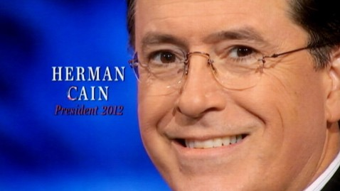 ann stephen colbert herman cain ad ll 120117 wblog The Cain Train Collides With Colberts Super PAC Satire