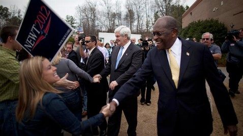 ap cain newt tk 120220 wblog Herman Cain Teaches Newt Gingrich How to Campaign