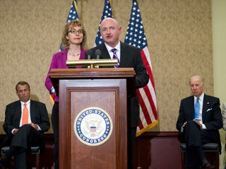 "PHOTO: Former Arizona Rep. Gabrielle Giffords listens as her husband, retired astronaut Mark Kelly speaks on Capitol Hill, in Washington on April 16, 2013, during a ceremony to honor Gabriel ""Gabe"" ..."