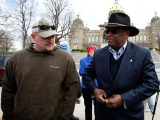 "PHOTO: Former Godfather's Pizza CEO Herman Cain talks with Samuel ""Joe the Plumber"" Wurzelbacher, left, before speaking at a tea party rally in this April 16, 2011 file photo at the Statehouse in Des ..."