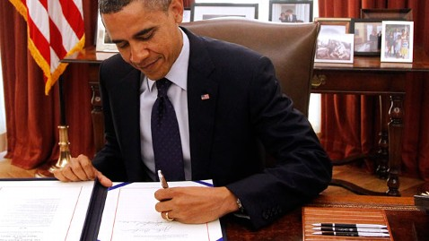 ap obama signing tax nt 111223 wblog Pension Perk Takes Hit as Congress Passes Reform Bill