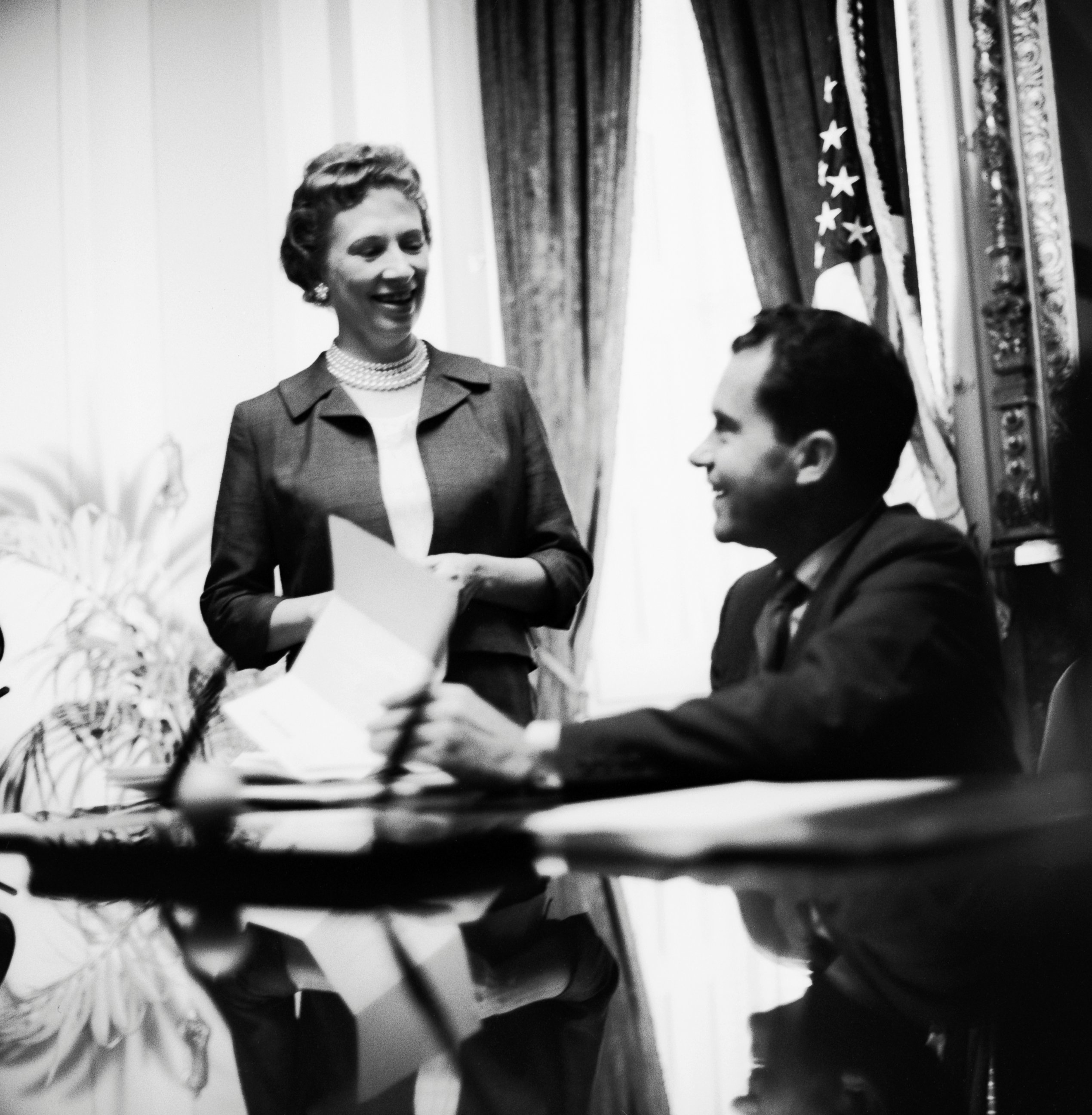 PHOTO: Rosemary Woods Talking to Richard Nixon in the Oval Office of the White House.