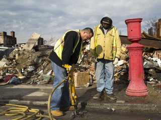 PHOTO: A jack-hammer operator from New York's Department of Environmental Protection, DEP, removes asphalt from a street, Jan. 17, 2013, to fix a leaking water pipe damaged during Hurricane Sandy in ...