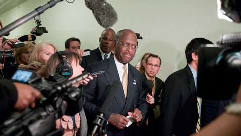 gty herman cain reporters thg 111102 wblog New Allegation of Harassment as Herman Cain Sees Rick Perry Campaigns Fingerprints on Revelations