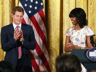 PHOTO: Prince Harry stands with first lady Michelle Obama during an event to honor military families at the White House, May 9, 2013 in Washington, DC.