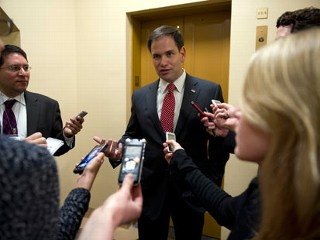 PHOTO: Sen. Marco Rubio, R-Fl., talks with reporters about immigration reform on his way to the luncheons in the U.S. Capitol, May 7, 2013.